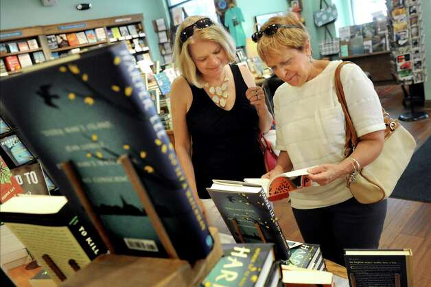 "Linda Lontrato of Rotterdam, left, accompanies Marilyn Halsdorf of Glenville as they look over the display of Harper Lee's ""Go Set a Watchman"" on Tuesday, July 14, 2015, at Northshire Bookstore in Saratoga Springs, N.Y. Halsdorf decided to purchase and reread ""To Kill a Mockingbird"" first. (Cindy Schultz / Times Union) Photo: Cindy Schultz / 00032591A"