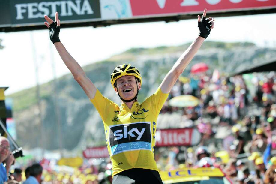 Britain's Christopher Froome, wearing the overall leader's yellow jersey, celebrates as he crosses the finish line to win the tenth stage of the Tour de France cycling race over 167 kilometers (103.8 miles) with start in Tarbes and finish in La Pierre-Saint-Martin, France, Tuesday, July 14, 2015. (AP Photo/Christophe Ena) ORG XMIT: PDJ126 Photo: Christophe Ena / AP
