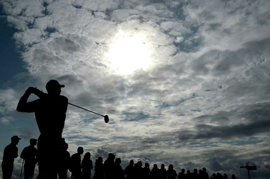 ST ANDREWS, SCOTLAND - JULY 13:  Tiger Woods of the United States plays a practice round ahead of the 144th Open Championship at The Old Course on July 13, 2015 in St Andrews, Scotland.  (Photo by Stuart Franklin/Getty Images) *** BESTPIX *** ORG XMIT: 541144521 Photo: Stuart Franklin / 2015 Getty Images