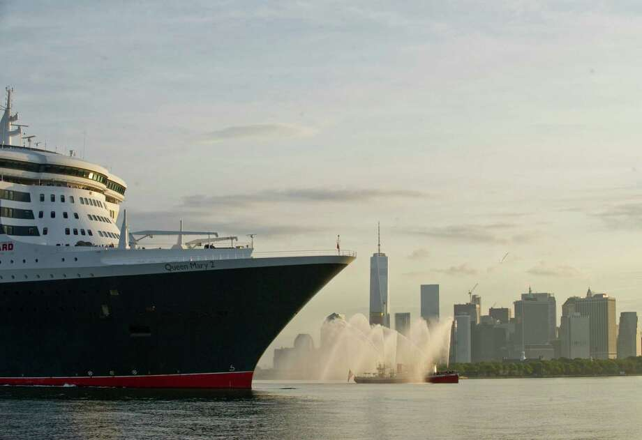 IMAGE DISTRIBUTED FOR CUNARD - Queen Mary 2 arrives in New York, the final leg of her 175th Anniversary tour, Tuesday, July 14, 2015. This month marks the 175th Anniversary of Cunard, and the company's flagship, Queen Mary 2, has recreated the historic Transatlantic Crossing from Liverpool to Halifax and Boston made by the RMS Britannia in July 1840.  Although not a port of call in the original crossing made by Britannia, New York has been Cunard's North American home port for over a century. (Photo by Diane Bondareff/AP Images for Cunard) ORG XMIT: CPANY101 Photo: Diane Bondareff / AP Images