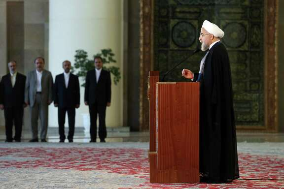 Iran's president Hassan Rouhani addresses the nation in a televised speech minutes after a landmark nuclear agreement was announced in Vienna, in Tehran, Iran, Tuesday, July 14, 2015. After long, fractious negotiations, world powers and Iran struck a historic deal Tuesday to curb Iran's nuclear program in exchange for billions of dollars in relief from international sanctions - an agreement aimed at averting the threat of a nuclear-armed Iran and another U.S. military intervention in the Middle East. (AP Photo/Ebrahim Noroozi) ORG XMIT: ENO114