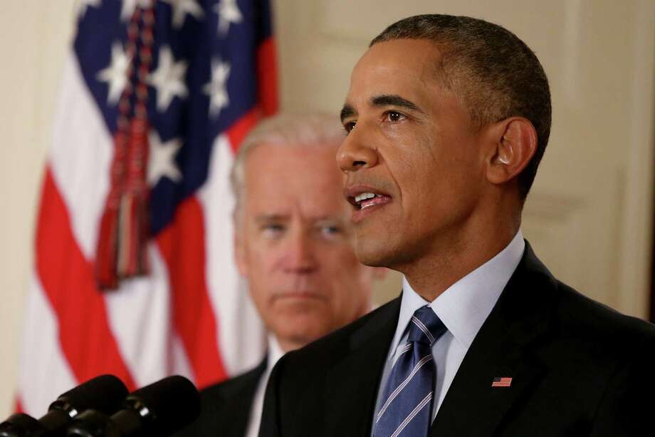 President Barack Obama, standing with Vice President Joe Biden, delivers remarks in the East Room of the White House in Washington, Tuesday, July 14, 2015, after an Iran deal is reached.  Obama says every path to a nuclear weapon will be cut off from Iran under a historic agreement announced in Vienna. (AP Photo/Andrew Harnik, Pool) ORG XMIT: WX105 Photo: Andrew Harnik / AP POOL