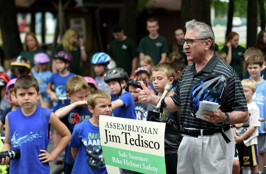 "Assemblyman Jim Tedisco pitches his Safe Summer Bike Helmet Safety program held today July 14, 2015 at Burgess- Kimball Memorial Park in Ballston Spa, N.Y.  12 area police departments are giving ""good tickets"",  which can be exchanged for ice cream at some local ice cream stores,  for children who wear bike helmets.   (Skip Dickstein/Times Union) Photo: SKIP DICKSTEIN / 00032593A"