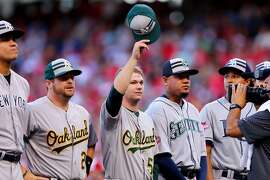 CINCINNATI, OH - JULY 14:  American League All-Star Stephen Vogt #21 of the Oakland Athletics and American League All-Star Sonny Gray #54 of the Oakland Athletics wave to the crowd prior to the 86th MLB All-Star Game at the Great American Ball Park on July 14, 2015 in Cincinnati, Ohio.  (Photo by Elsa/Getty Images)