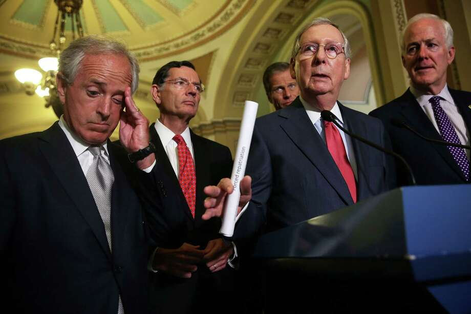 WASHINGTON, DC - JULY 14:  (L-R) U.S. Sen. Bob Corker (R-TN), Sen. John Barrasso (R-WY), Sen. John Thune (R-SD), Senate Majority Leader Sen. Mitch McConnell (R-KY) and Senate Majority Whip Sen. John Cornyn (R-TX) speak to members of the media after the weekly Republican Policy Luncheon July 14, 2015 on Capitol Hill in Washington, DC. Senate Republicans spoke on various topics including the Iran talks deal.  (Photo by Alex Wong/Getty Images) Photo: Alex Wong, Staff / Getty Images / 2015 Getty Images