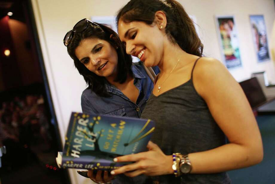 """Sonia Nanwani (left) and Nikita Nanwani look at Harper Lee's """"Go Set a Watchman"""" at a store in Coral Gables, Fla. Reports indicate """"Watchman"""" is an early version of """"To Kill a Mockingbird."""" Photo: Joe Raedle /Getty Images / 2015 Getty Images"""