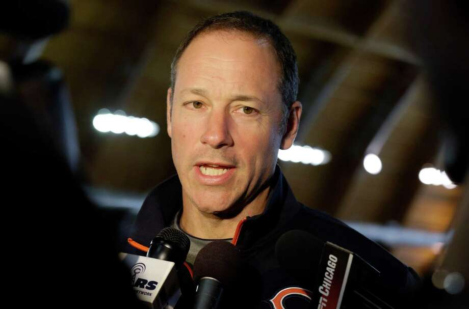 FILE - In this April 18, 2013, file photo, then-Chicago Bears offensive coordinator Aaron Kromer talks to reporters during the team's NFL football minicamp at Halas Hall in Lake Forest, Ill. Buffalo Bills President Russ Brandon says offensive line coach Aaron Kromer has been put on paid administrative leave after being accused of punching a boy in the face for using his beach chairs.  Kromer joined the team in January after being fired from the Chicago Bears. (AP Photo/Nam Y. Huh) ORG XMIT: ILNH125 Photo: Nam Y. Huh / AP