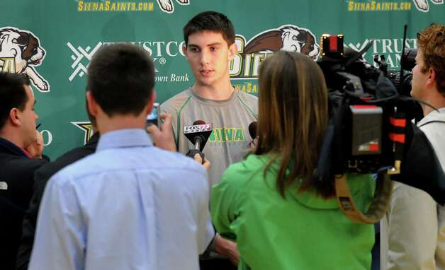 Siena basketball player Ryan Rossiter, center, fields questions during Media Day on Friday, Oct. 15, 2010, at Siena College in Loudenville, N.Y. (Cindy Schultz / Times Union) Photo: Cindy Schultz / 00010635A