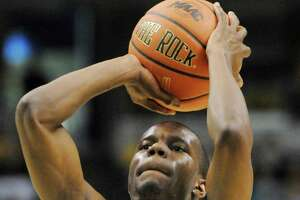 Siena Men's Basketball player No. 25, Ronald Moore, takes his shot.  The Saints beat Rider in the semifinal round  of the 2010 MAAC Championship Tournament on Sunday, March 7, 2010, at the Times Union Center in Albany, NY.  The Siena men won the game & will play for the championship Monday night at 7 PM.   BASKETBALL COLLEGE SPORTS    (Luanne M. Ferris / Times Union)
