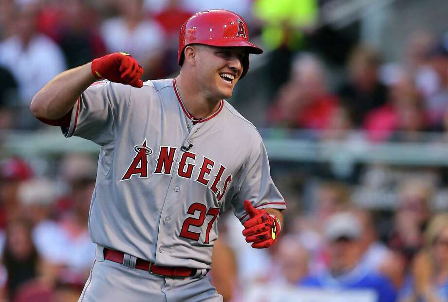 CINCINNATI, OH - JULY 14:  American League All-Star Mike Trout #27 of the Los Angeles Angels of Anaheim celebrates after hitting a lead off home run in the first inning against National League All-Star Zack Greinke #21 of the Los Angeles Dodgers during the 86th MLB All-Star Game at the Great American Ball Park on July 14, 2015 in Cincinnati, Ohio.  (Photo by Elsa/Getty Images) ORG XMIT: 554358343 Photo: Elsa / 2015 Getty Images