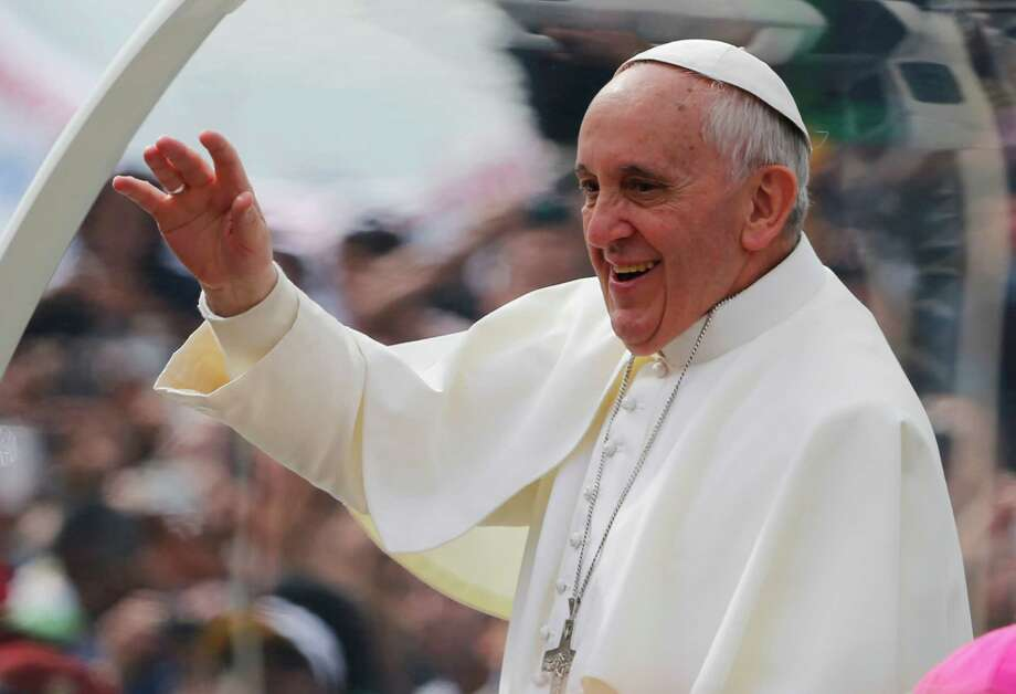 Pope Francis waves from his popemobile along the Copacabana beachfront on his way to celebrate Mass in Rio de Janeiro, Brazil, Sunday, July 28, 2013. Hundreds of thousands of young people slept under chilly skies in the white sand awaiting Francis' final Mass for World Youth Day.  (AP Photo/Jorge Saenz) Photo: Jorge Saenz / Associated Press / AP
