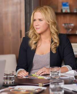 """This photo provided by Universal Pictures shows, Amy Schumer as Amy, in """"Trainwreck,"""" the new comedy from director/producer Judd Apatow. The movie releases in the U.S. on July 17, 2015.  (Mary Cybulski/Universal Pictures via AP)"""