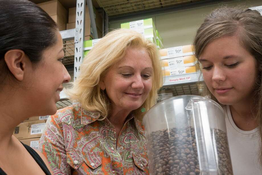 "Katz Coffee employee Celina Sandoval, left, gives Debbie Markey and Katie Campbell of the Houston Arboretum and Nature Center a chance to sniff the new Katz roast, ""Arboretum Early Bird,"" to raise money for the center. Photo: R. Clayton McKee, Freelance / ©2015 R. Clayton McKee"