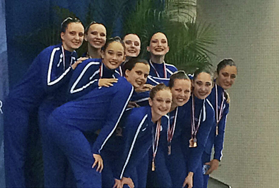 Members of the New Canaan YMCA Aquianas 13-15 age group captured third place for their team performance at the recent  U.S. Junior Olympics Synchronized Swimming Championships. Photo: Contributed / Contributed Photo / New Canaan News