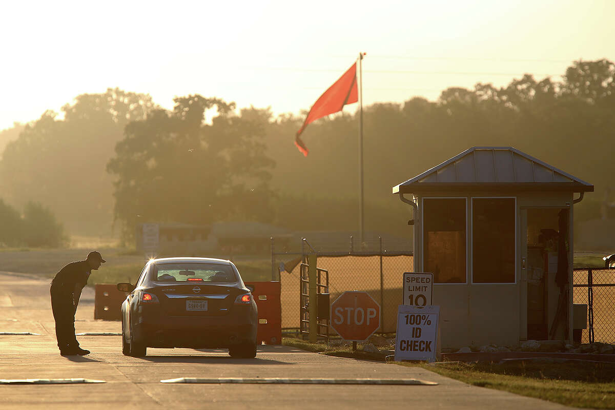 A security guard checks incoming traffic at Camp Swift, Texas, north of Bastrop, Texas, Wednesday, July 15, 2015. It is the first day of the U.S. Army Special Operations exercise,