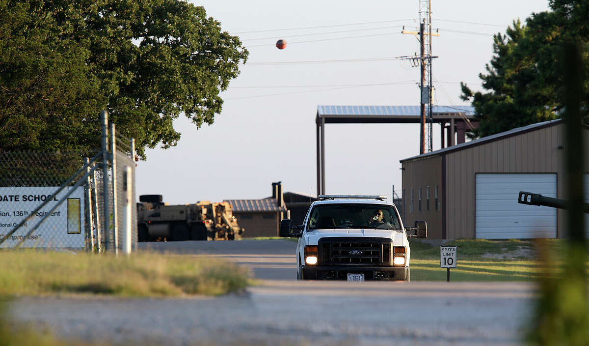 A vehicle makes its way around the southern part of Camp Swift, Texas, north of Bastrop, Texas, Wednesday, July 15, 2015. It is the first day of the U.S. Army Special Operations exercise,