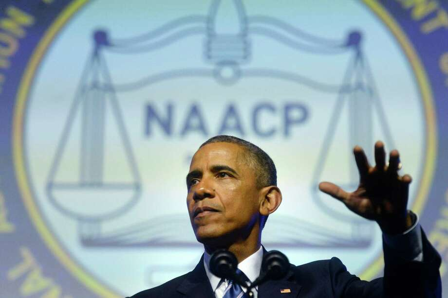 President Barack Obama addresses the 106th annual NAACP national conference at the Pennsylvania Convention Center, Tuesday, July 14, 2015 in Philadelphia. Gov. Dannel P. Malloy was one of two governors invited by Obama to attend a major policy speech to the group on criminal justice reform. Malloy was recognized for his work by President Barack Obama at the convention. Photo: Tom Gralish / Associated Press / Associated Press