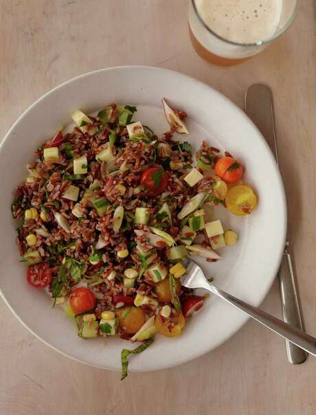 "Pictured here, Red Rice Salad with Cherry Tomatoes, Cucumbers and Corn from ""Franny's Simple seasonal Italian"" by Andrew Feinberg, Francine Stephens and Melissa Clark (Artisan Books). Photo: Courtesy Artisan Books / Copyright: John von Pamer"