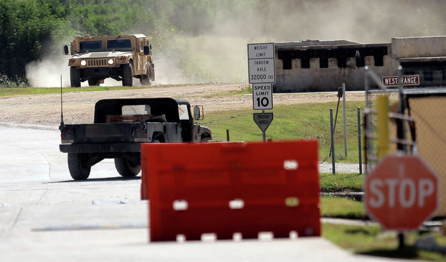 Military vehicles are seen at Texas Army National Guard Camp Swift, Wednesday, July 15, 2015, in Bastrop, Texas. Jade Helm 15, a summer military training exercise, that has aroused alarm among archconservative Texans, begins Wednesday outside the Central Texas town of Bastrop. (AP Photo/Eric Gay) Photo: Eric Gay, Associated Press / AP