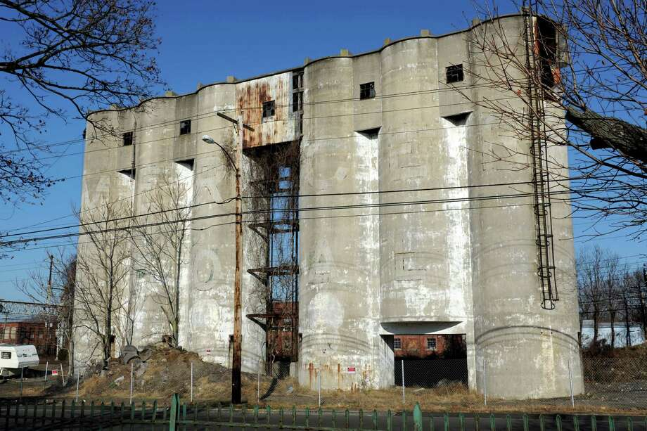The Mercer Coal silos on Stratford Avenue in Stratford are set to be demolished this month. The property is one of several to have been awarded funds from the state brownfields program in recent years. Photo: Hearst Connecticut Media File Photo / Connecticut Post