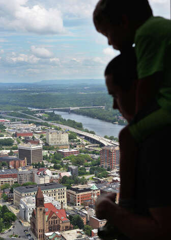 Steven DiBenedetto of Rochester holds his son Antonio DiBenedetto, 4, on his shoulders as they take in a birds-eye-view of the city from the observation deck of the Corning Tower Tuesday July 14, 2015 in Albany, NY.  (John Carl D'Annibale / Times Union) Photo: John Carl D'Annibale, Albany Times Union