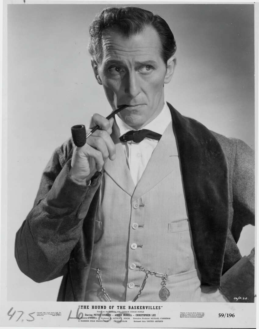 FILE-- Peter Cushing in The Hound of the Baskervilles 1959. Peter Cushing Played Sherlock Holmes In The 1959 Movie Of