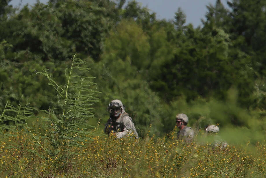"Military personnel train at Camp Swift north of Bastrop,Texas, Wednesday, July 15, 2015. The U.S. Army Special Operations exercise, ""Jade Helm 15,"" started this morning at the camp. The operation brings 1,200 troops to Texas, Arizona, Florida, Louisiana, Mississippi, Utah and New Mexico. It is expected to last through mid-September. Conspiracy theorist have voice concern that the operation will lead to suspension of civil liberties and the government imposing martial law. Photo: JERRY LARA, Staff / San Antonio Express-News / © 2015 San Antonio Express-News"