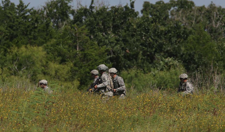 """Military personnel train at Camp Swift north of Bastrop,Texas, Wednesday, July 15, 2015. The U.S. Army Special Operations exercise, """"Jade Helm 15,"""" started this morning at the camp. The operation brings 1,200 troops to Texas, Arizona, Florida, Louisiana, Mississippi, Utah and New Mexico. It is expected to last through mid-September. Conspiracy theorist have voice concern that the operation will lead to suspension of civil liberties and the government imposing martial law. Photo: JERRY LARA, Staff / San Antonio Express-News / © 2015 San Antonio Express-News"""