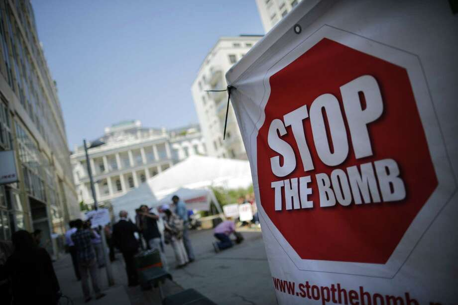 "A sign which reads ""Stop the Bomb"" is seen as protesters gather outside the hotel where the Iran nuclear talks meetings were being held in Vienna, Austria, earlier this month. Photo: CARLOS BARRIA /AFP / Getty Images / AFP"