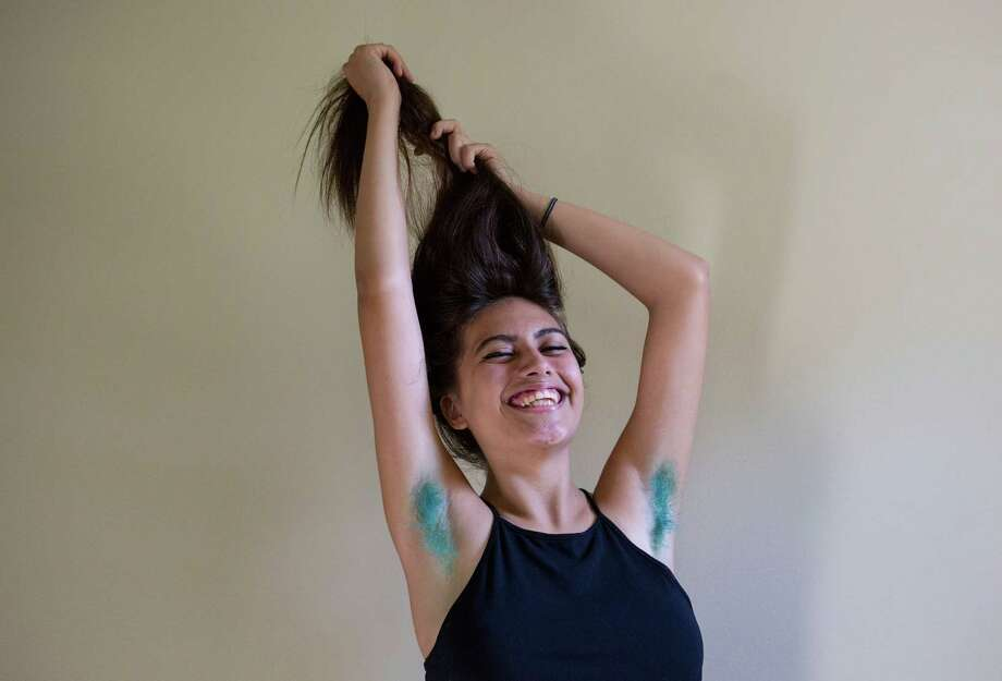 Destiny Moreno, 17, who dyed her underarm hair as a feminist stance and has received more than 264,000 views on YouTube for a video in which she showed off her new look, in Marysville, Wash., July 12, 2015. The Internet is up to its armpits with women who dye their armpit hair, including Miley Cyrus, who displayed her pink underarms in a photo posted on Instagram. Photo: RUTH FREMSON, New York Times / NYTNS