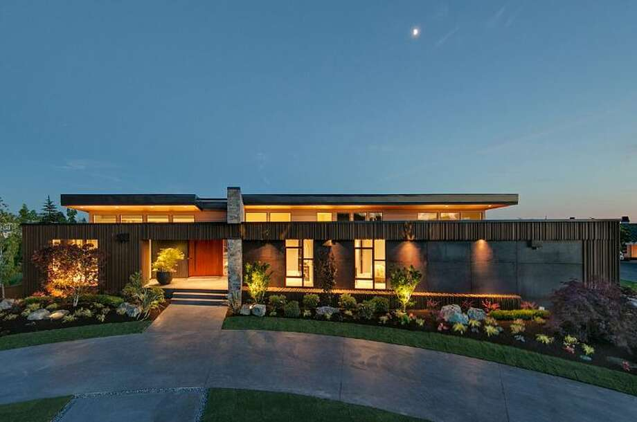 This home, 9115 N.E. 19th St. in Clyde Hill, is listed for $6.288 million. The five bedroom, 4.75 bathroom home is just over 6,500 square feet. It features panoramic views of Mt. Rainier, Lake Washington and Seattle. 