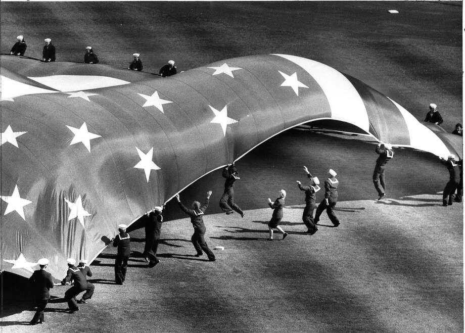 The wind lifted several sailors holding the flag at the 1984 All-Star Game at Candlestick Park. Photo: Frederic Larson, The Chronicle
