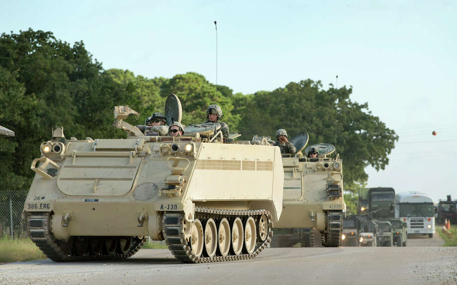 A convoy of National Guard troops moves on Camp Swift, which is also hosting the Operation Jade Helm 15 military exercise, in Bastrop, Texas, on Wednesday July 15, 2015.  Jade Helm 15 is summer military training exercise  that has aroused alarm among archconservative Texans.  Photo: Jay Janner, Associated Press / Austin American-Statesman