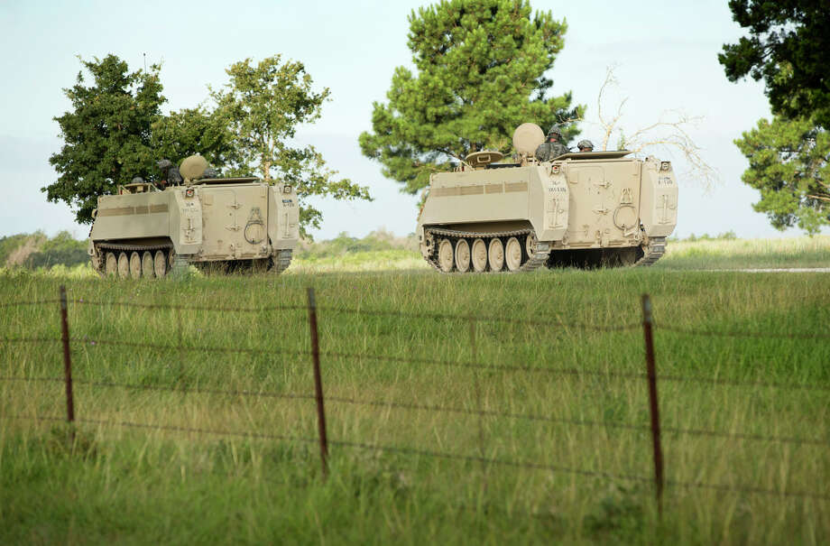 A convoy of National Guard troops moves on Camp Swift, which is also hosting the Operation Jade Helm 15 military exercise, in Bastrop, Texas, on Wednesday July 15, 2015.  Jade Helm 15 is summer military training exercise  that has aroused alarm among archconservative Texans.  (Jay Janner/Austin American-Statesman via AP)  AUSTIN CHRONICLE OUT, COMMUNITY IMPACT OUT, INTERNET AND TV MUST CREDIT PHOTOGRAPHER AND STATESMAN.COM, MAGS OUT; MANDATORY CREDIT Photo: Jay Janner, Associated Press / Austin American-Statesman