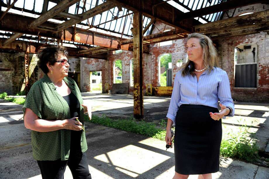 At left, Redding Tax Collector Patricia Moisio, left, and First Selectman Julia Pemberton talk about the former Gilbert and Bennett wire mill property in Redding. Photo: Carol Kaliff / Carol Kaliff / The News-Times