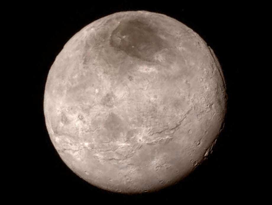 Remarkable new details of Pluto's largest moon Charon are revealed in this image from New Horizons' long-range camera. Photo: NASA