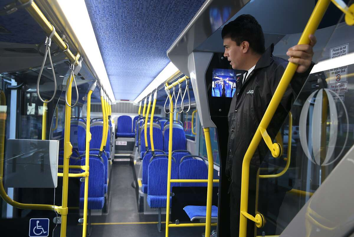 AC Transit ambassador Orlando Perez makes sure passengers grabbed their belongings from the lower deck after a commuter run to Stanford, Calif. on Tuesday, Feb. 24, 2015. AC Transit tested the 80-seat, double- decker buses and has decided to buy a number of them.