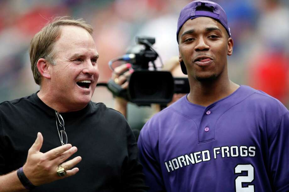 TCU head football coach Gary Patterson, left, and quarterback Trevone Boykin, right, talk on the field before Boykin threw out the ceremonial first pitch in an interleague baseball game between the Arizona Diamondbacks and Texas Rangers Wednesday, July 8, 2015, in Arlington, Texas. Photo: Tony Gutierrez /Associated Press / AP