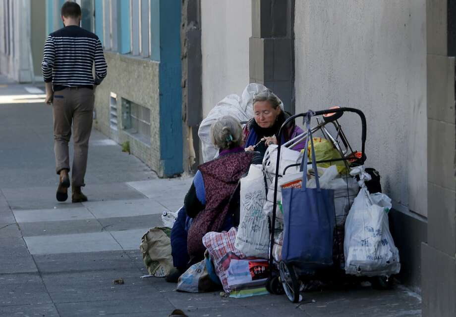 Two longtime homeless women from the Ukraine set up camp on Howard Street Wednesday July 15, 2015. Although San Francisco housed over 3000 homeless people in the last two years, the overall homeless count stubbornly remains about the same. Photo: Brant Ward, The Chronicle
