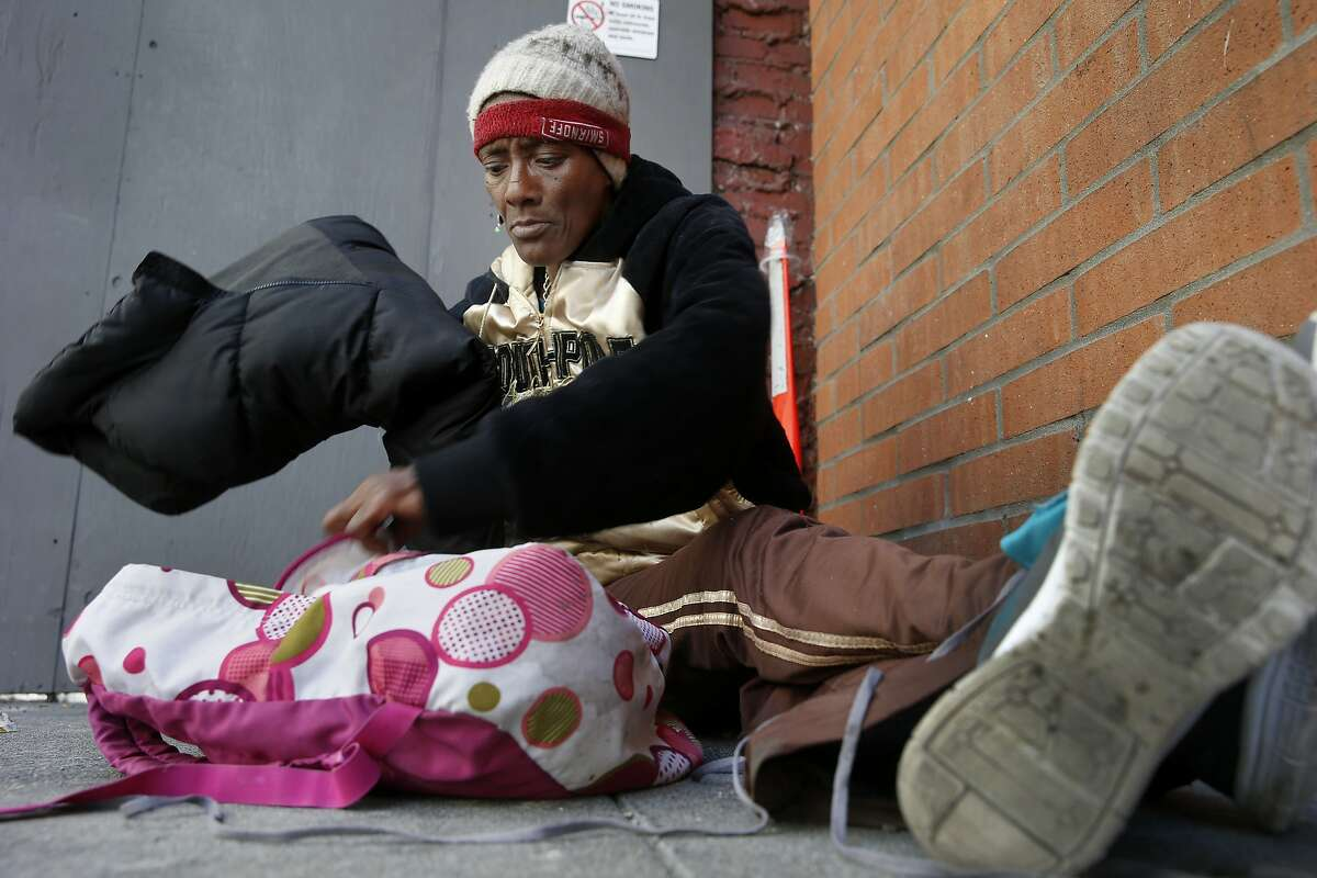 A homeless woman named Listern got her belongings together as she sat on O'Farrell Street near Union Square Wednesday July 15, 2015. Although San Francisco housed over 3000 homeless people in the last two years, the overall homeless count stubbornly remains about the same.