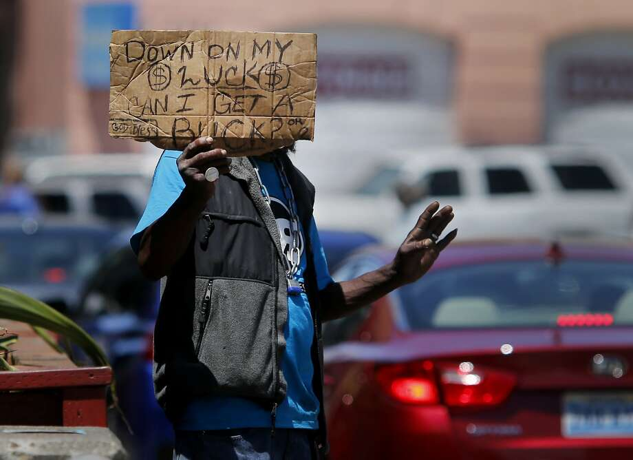 A homeless panhandler plied his trade as traffic came off the freeway near 13th Street Wednesday July 15, 2015. Although San Francisco housed over 3000 homeless people in the last two years, the overall homeless count stubbornly remains about the same. Photo: Brant Ward, The Chronicle