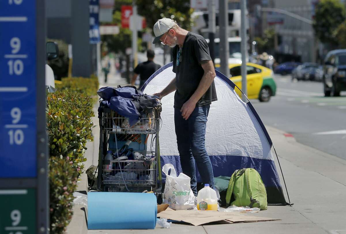 Fifty seven year old homeless man Henry Broughton set up his tent on Howard Street in the middle of the sidewalk Wednesday July 15, 2015. Although San Francisco housed over 3000 homeless people in the last two years, the overall homeless count stubbornly remains about the same.