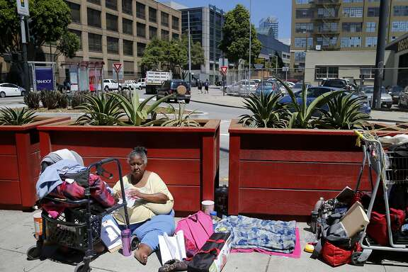Longtime homeless woman Patricia (no last name given) sat on the sidewalk near 13th Street Wednesday July 15, 2015. Although San Francisco housed over 3000 homeless people in the last two years, the overall homeless count stubbornly remains about the same.