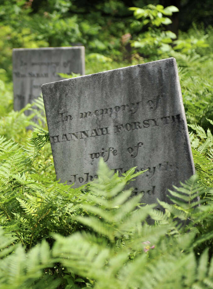 In this June 15, 2010 file photo, grave markers poke through an overgrown area of an abandoned cemetery in Montville, Conn. Connecticut is now the most expensive place to die in the U.S. at least for the wealthy after the new budget took effect on July 1, 2015, that eliminated a cap on probate fees, cut state funding to probate courts and doubled the fee on estates worth more than $2 million. Photo: Jessica Hill / Associated Press / FR125654 AP