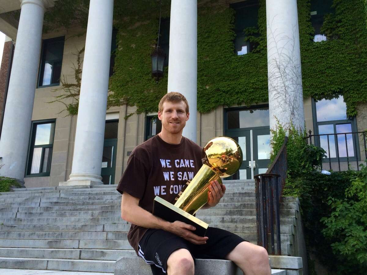 Spurs forward Matt Bonner look the Larry O'Brien trophy around Concord, New Hampshire.