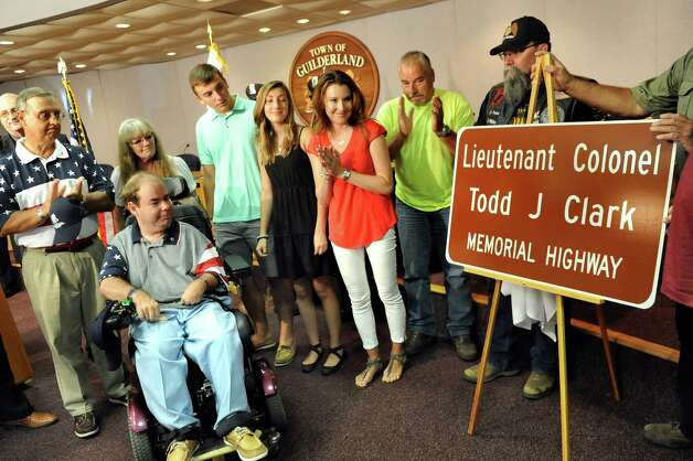 The family of Lt. Col. Todd J. Clark are present for the unveiling of a sign to rename a portion of Route 146 in his honor during a dedication ceremony on Wednesday, July 15, 2015, at Guilderland Town Hall in Guilderland, N.Y. (Cindy Schultz / Times Union) Photo: Cindy Schultz / 00032642A