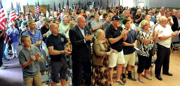 The audience gives a standing ovation during a dedication ceremony to name a portion of Route 146 in honor of Lt. Col. Todd J. Clark on Wednesday, July 15, 2015, at Guilderland Town Hall in Guilderland, N.Y. (Cindy Schultz / Times Union) Photo: Cindy Schultz / 00032642A