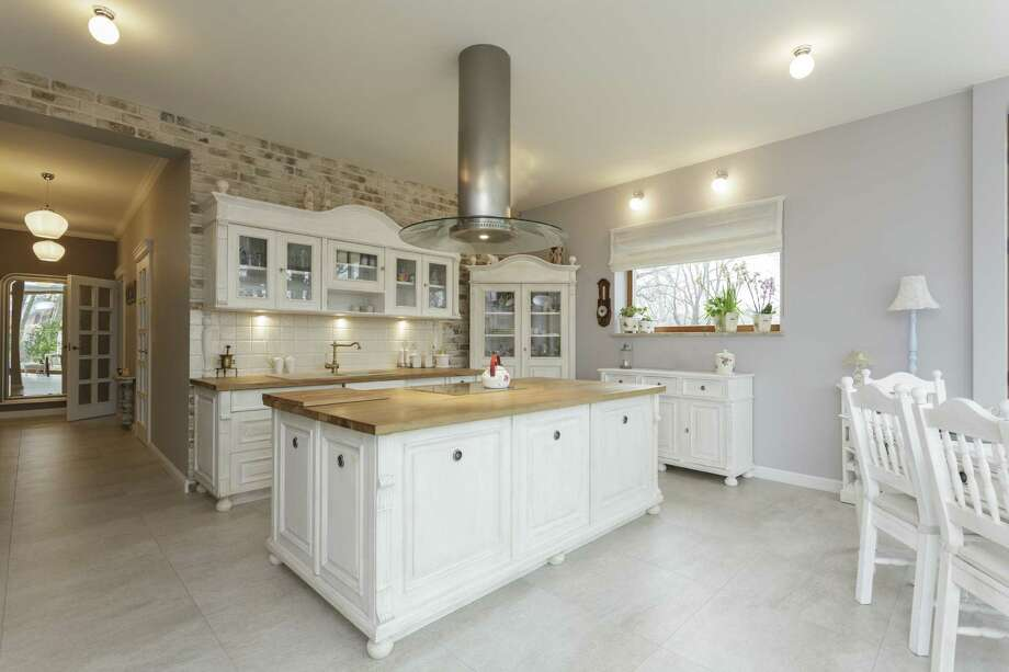 White painted kitchen cabinetry is another popular design trend. Photo: KatarzynaBialasiewicz / iStockphoto