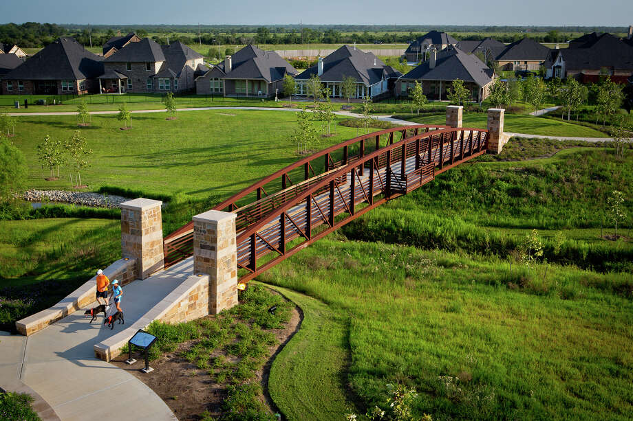The Johnson Development Corp. is behind many of Houston's top-selling master-planned communities known for outstanding amenities, top schools, quality home builders and prime locations. Shown is an aerial view of Flewellen Creek Park at Cross Creek Ranch in Fulshear.