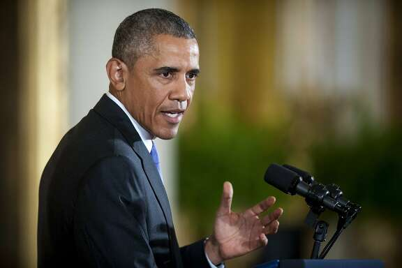 U.S. President Barack Obama speaks at a news conference in the East Room of the White House in Washington, D.C., U.S., on Wednesday, July 15, 2015. Obama mounted a forceful defense of the accord intended to keep Iran from obtaining nuclear weapons, challenging opponents of the deal to say they would be prepared to wage war on the Islamic Republic instead. Photographer: Pete Marovich/Bloomberg *** Local Caption *** Barack Obama